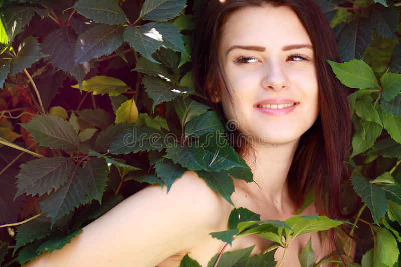 Whild Grape goddess. Beautiful young lady, wrapped in grap royalty free stock images