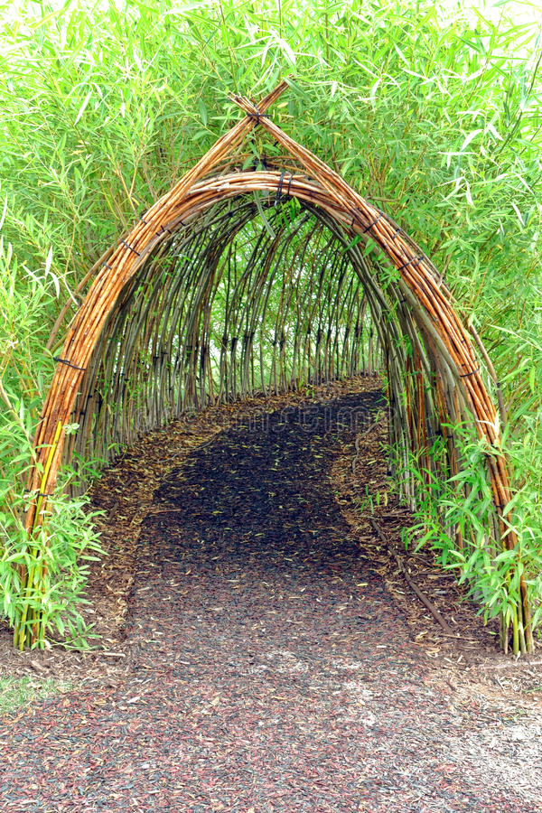 Whimsical Bamboo Tunnel in Children Amusement Park stock photos