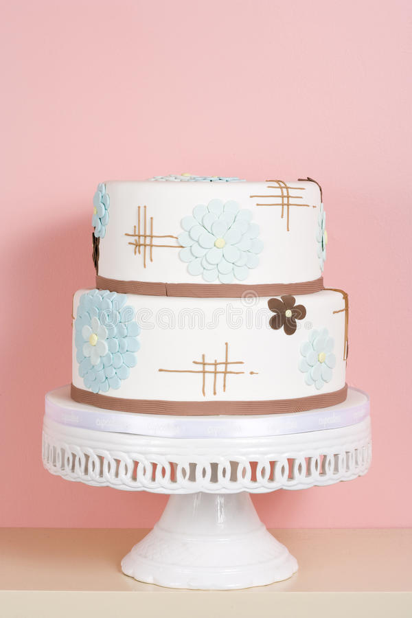 Whimsical Cake Against Pink Background stock photos