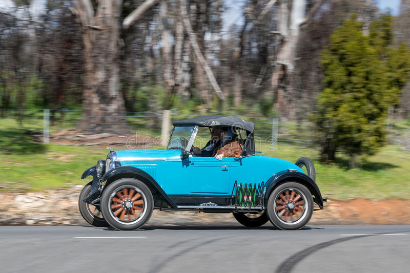 1928 Whippet 96 Roadster. Adelaide, Australia - September 25, 2016: Vintage 1928 Whippet 96 Roadster driving on country roads near the town of Birdwood, South royalty free stock images