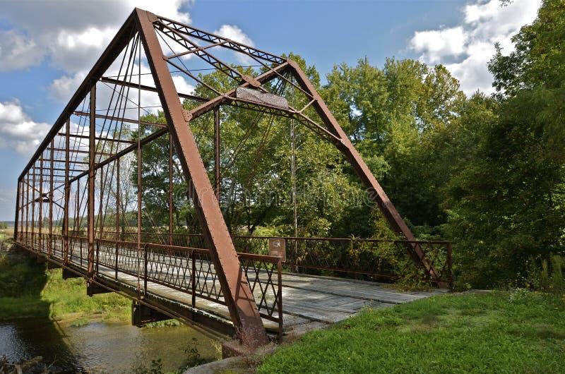 Whipple Truss Bridge. A whipple truss bridge spans the Big Raccoon River in Parke County near Bridgeton, Indiana stock photo