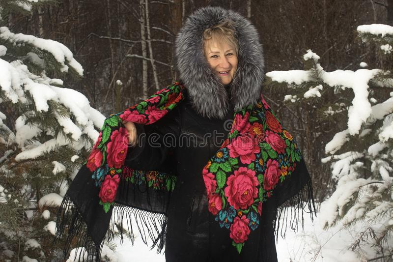 Whirl granny in flower print shawl winter outdoors stock image