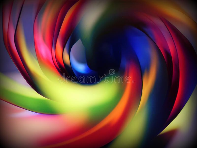 Whirl of a rainbow colors. Beautiful photo whirl of a rainbow coloured paper sheets with warm and cold colors stock photo