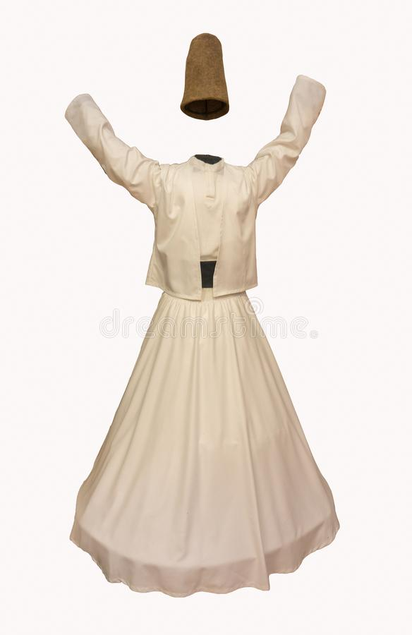 Whirling Dervish Costume. Everyone is familiar with the image of the whirling dervish, clad completely in white and spinning expertly as if in a trance. However royalty free stock photo
