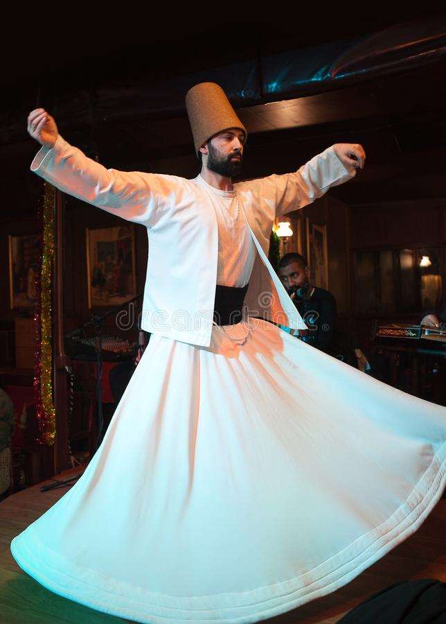Whirling Dervish dance in Istanbul, Turkey. ISTANBUL, TURKEY - JANUARY 13, 2018: Whirling Dervish dance. It is called Sema and is a part of the inspiration of royalty free stock photo
