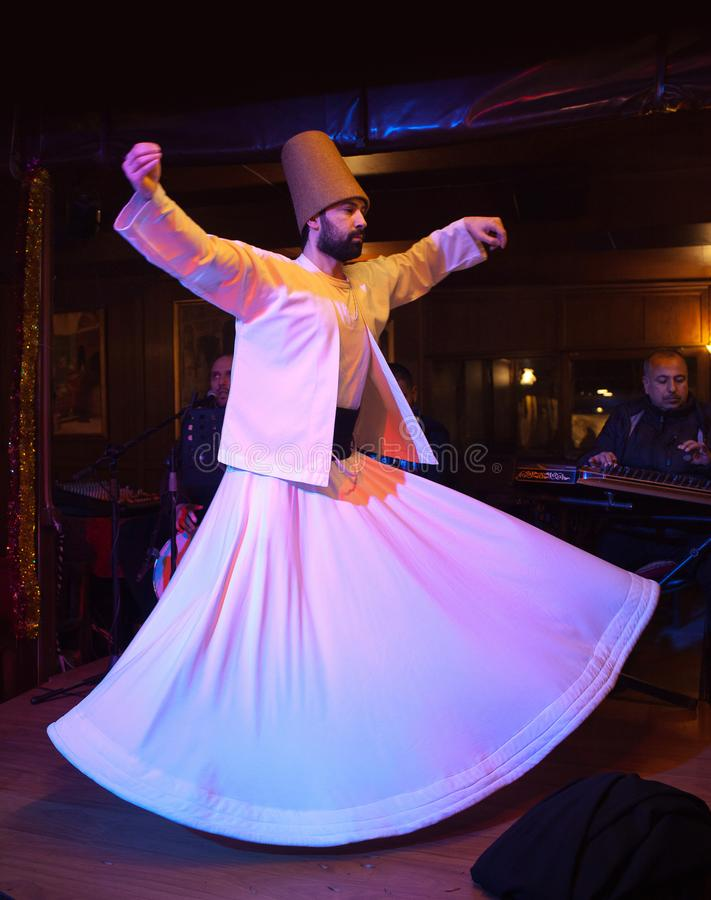 Whirling Dervish dance in Istanbul, Turkey. ISTANBUL, TURKEY - JANUARY 13, 2018: Whirling Dervish dance. It is called Sema and is a part of the inspiration of stock image