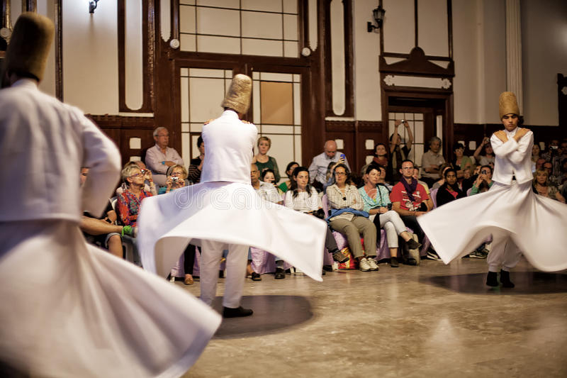 Whirling Dervishes. ISTANBUL - April 29: Whirling Dervishes perform a sacred dance of the Sufi Mevlevi Order at Serkeci Train Station on April 29, 2014 in stock image