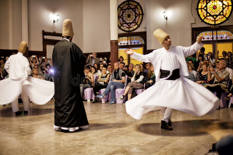 Whirling Dervishes. ISTANBUL - April 29: Whirling Dervishes perform a sacred dance of the Sufi Mevlevi Order at Serkeci Train Station on April 29, 2014 in royalty free stock photography