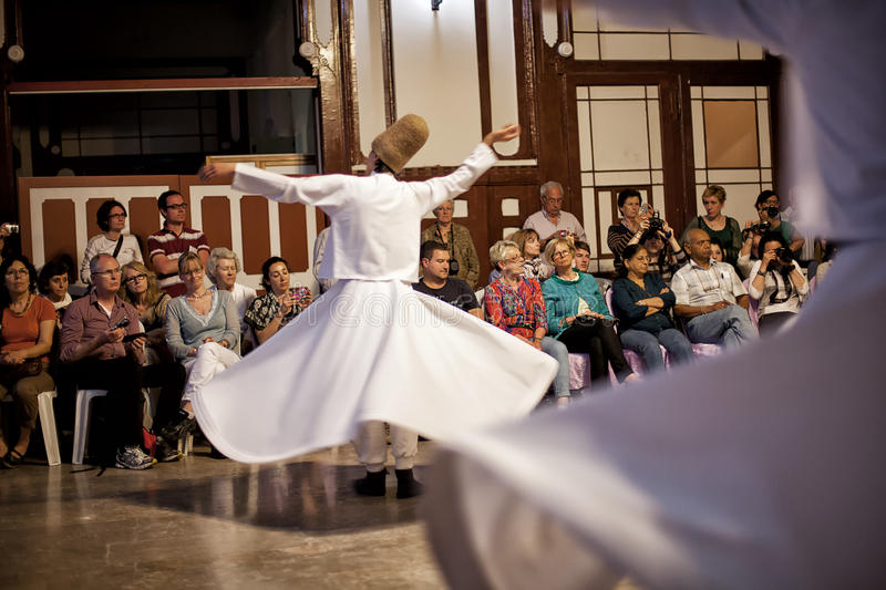 Whirling Dervishes. ISTANBUL - April 29: Whirling Dervishes perform a sacred dance of the Sufi Mevlevi Order at Serkeci Train Station on April 29, 2014 in royalty free stock photo