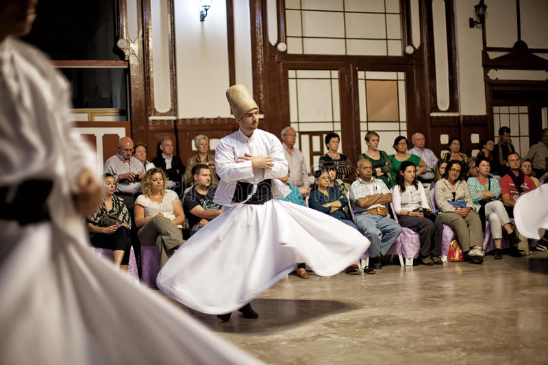 Whirling Dervishes. ISTANBUL - April 29: Whirling Dervishes perform a sacred dance of the Sufi Mevlevi Order at Serkeci Train Station on April 29, 2014 in royalty free stock images