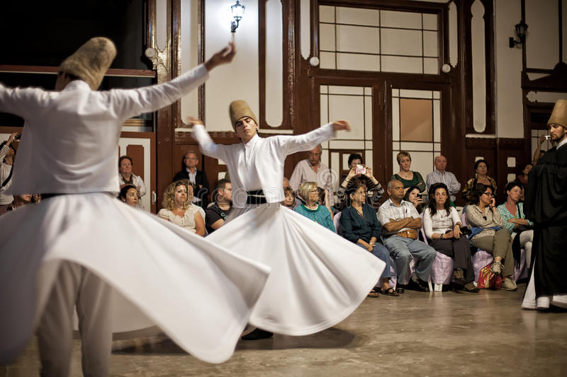 Whirling Dervishes. ISTANBUL - April 29: Whirling Dervishes perform a sacred dance of the Sufi Mevlevi Order at Serkeci Train Station on April 29, 2014 in stock images