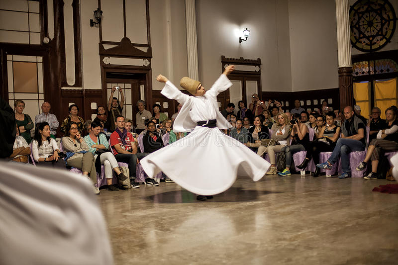 Whirling Dervishes. ISTANBUL - April 29: Whirling Dervishes perform a sacred dance of the Sufi Mevlevi Order at Serkeci Train Station on April 29, 2014 in stock photo