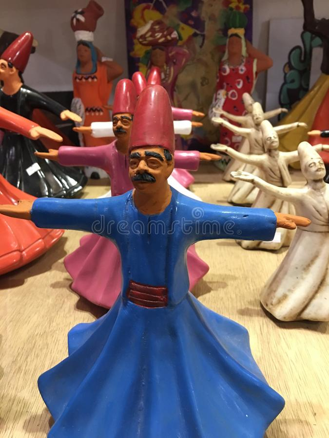 Whirling Dervishes statue in old Cairo. The Mawlaw`Ä«yya / Mevlevi Order is a Sufi order in Konya founded by the followers of Jalal ad-Din Muhammad Balkhi stock photography