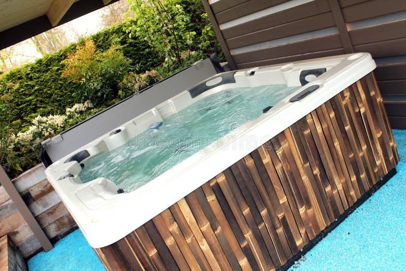 Whirlpool 2. A luxury whirlpool in the backyard royalty free stock photo