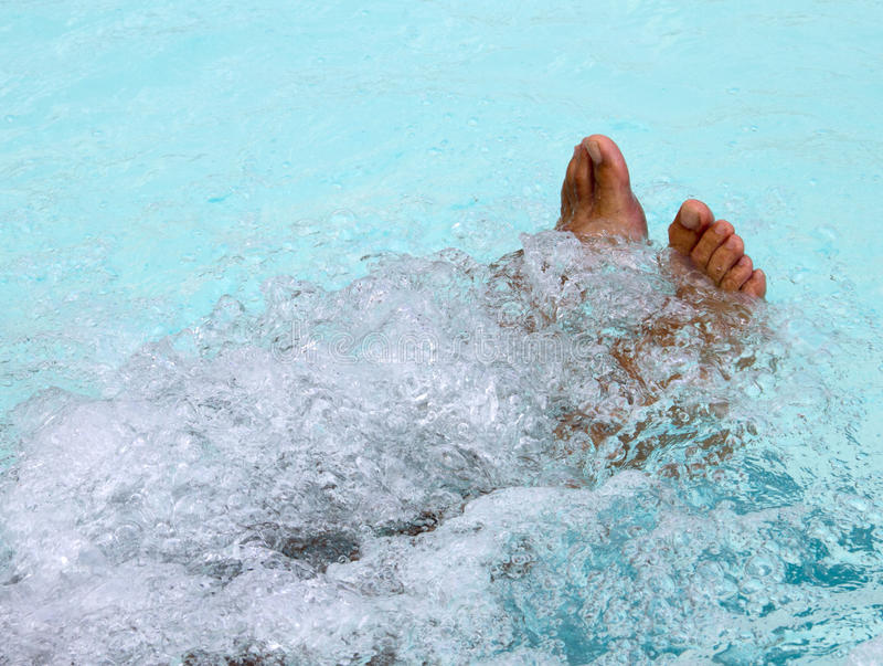 Whirlpool. Feet in whirlpool between the bubbles royalty free stock images
