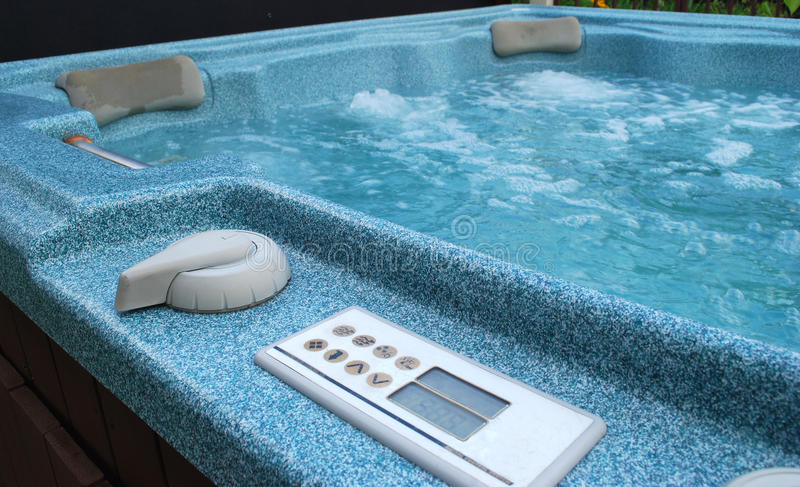 Whirlpool bath. A blue whirlpool bath outside royalty free stock images