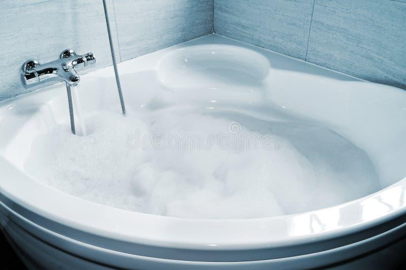 Whirlpool bath. A whirlpool bath full of foam ready to take a bath royalty free stock photos