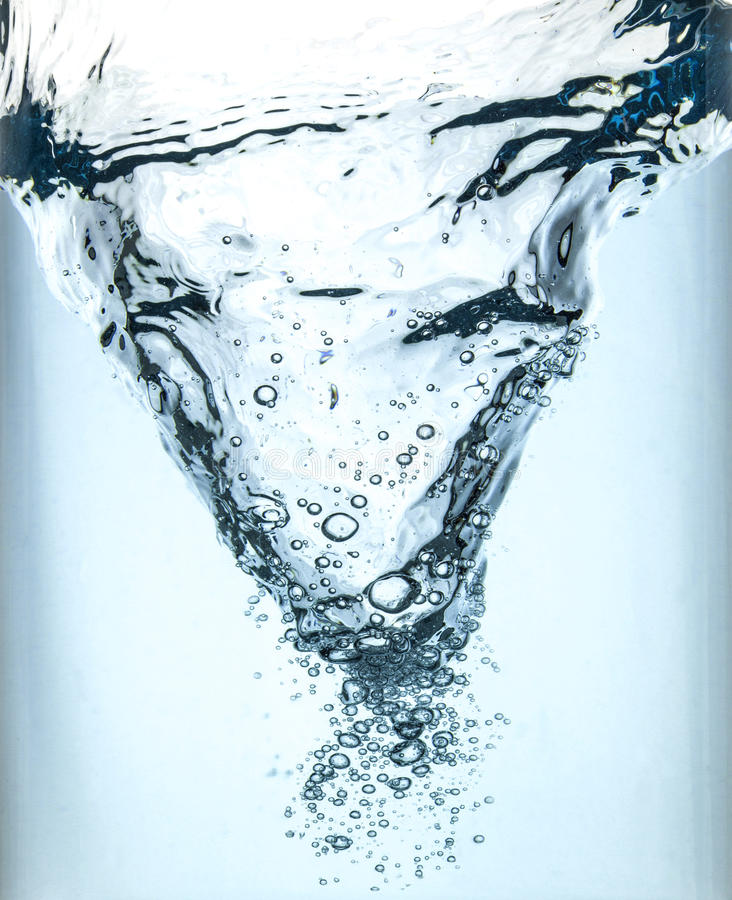 Whirlpool in blue water. In a glass container stock photos