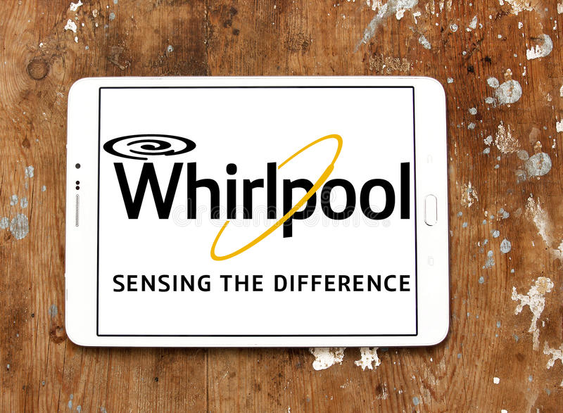 Whirlpool logo. Logo of electronics and kitchen appliance company whirlpool on samsung tablet on wooden background stock photography