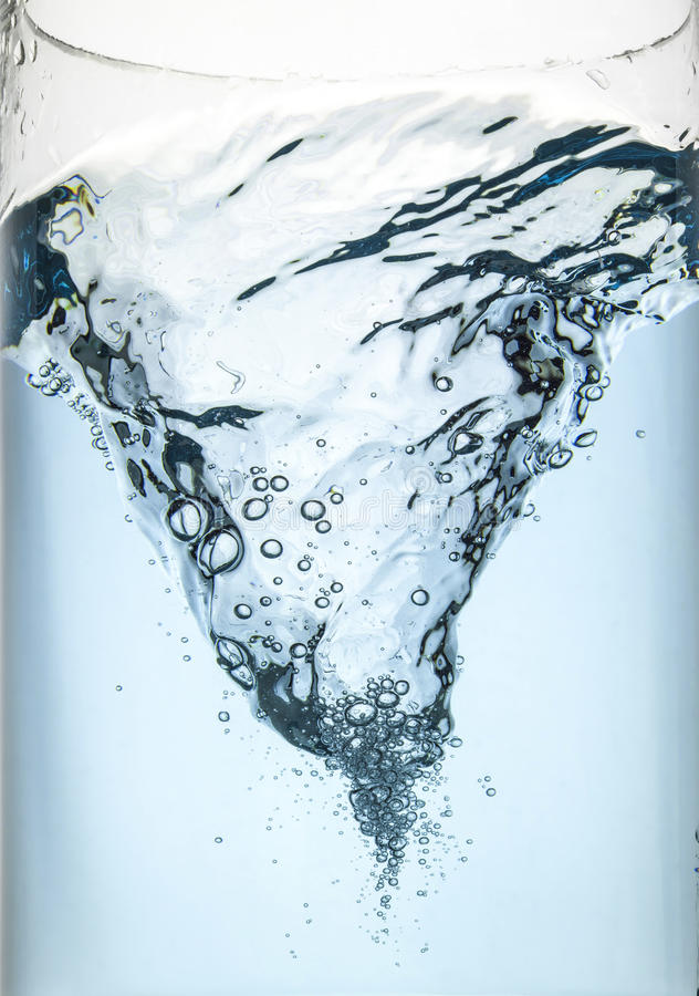Whirlpool underwater in blue. In glass royalty free stock images
