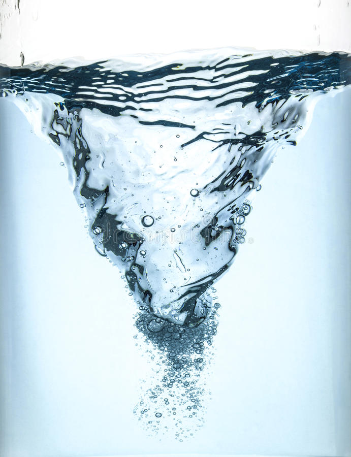 Whirlpool underwater in blue. In a glass container royalty free stock photos