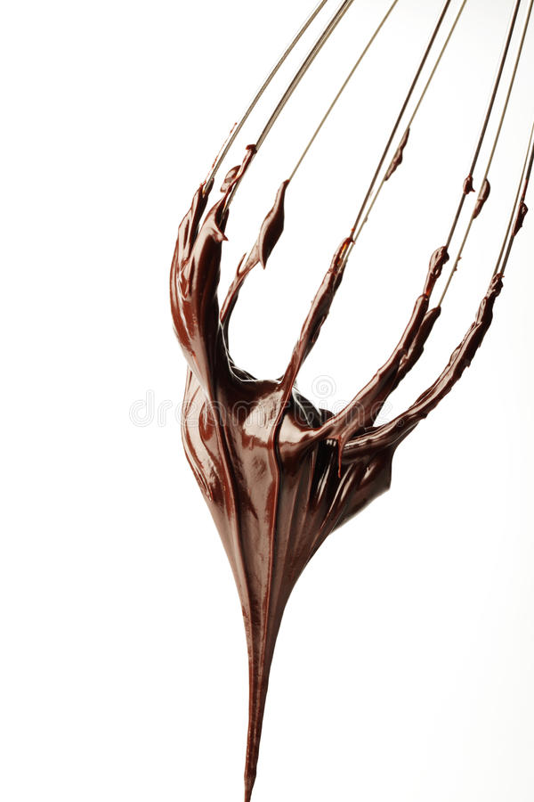 Whisk with chocolate royalty free stock photos
