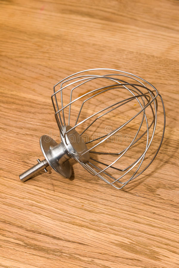 Whisk. Of electric mixer on wooden background stock photos