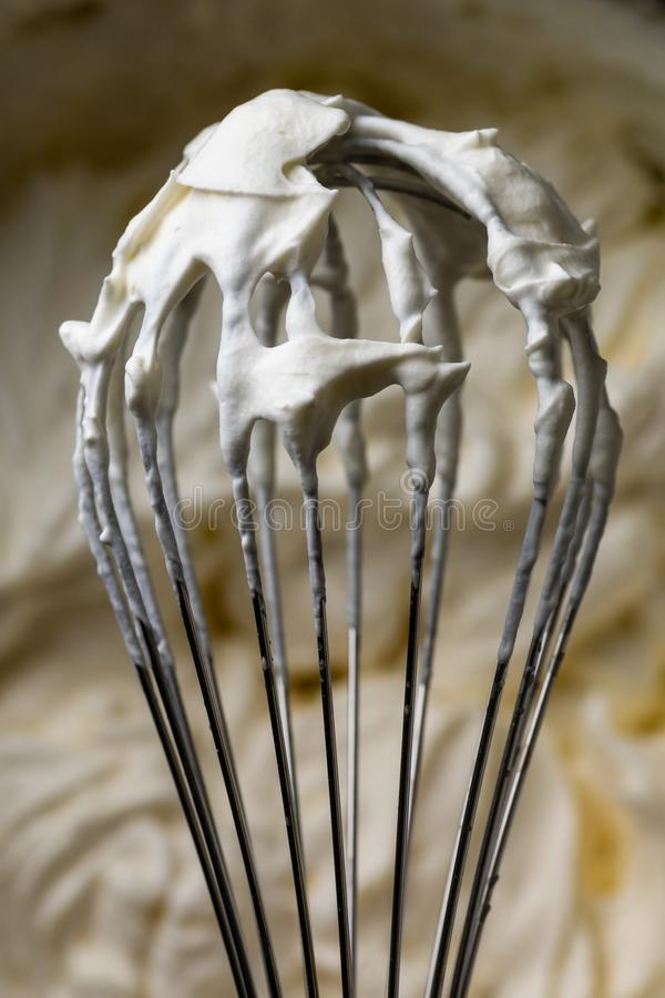 Whisk for whipping cream. Cooking cream. Metal whisk. For mixing stock photos