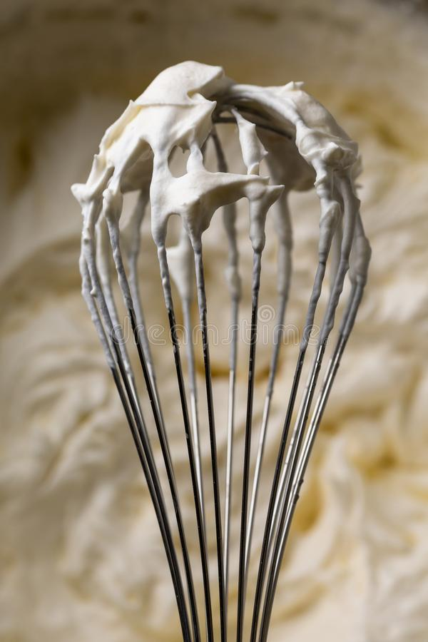 Whisk for whipping cream. Cooking cream. Metal whisk. For mixing stock photography