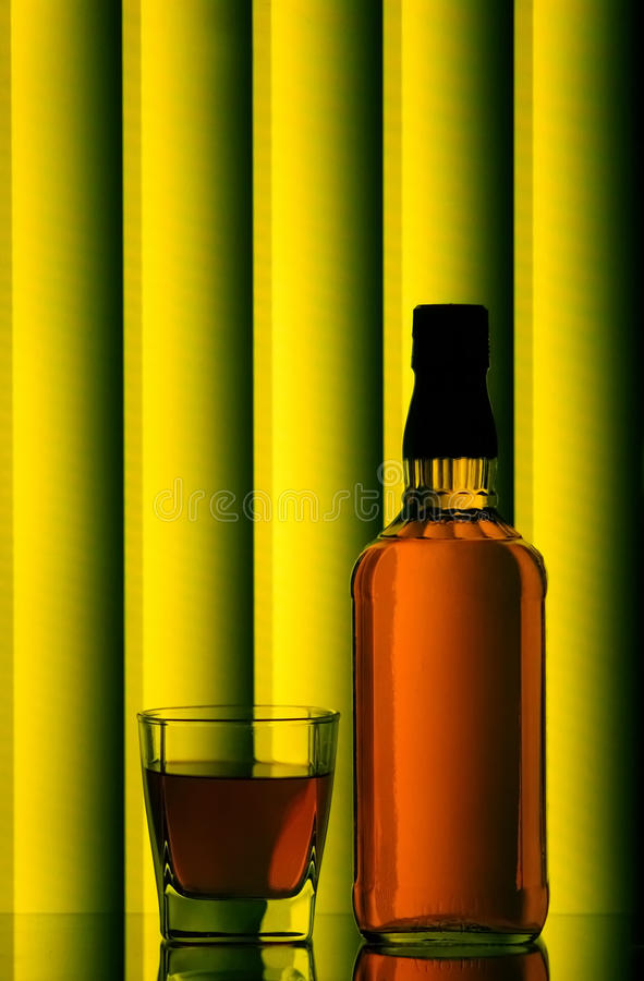 Download Whiskey bottle and glass stock image. Image of reflections - 16909311