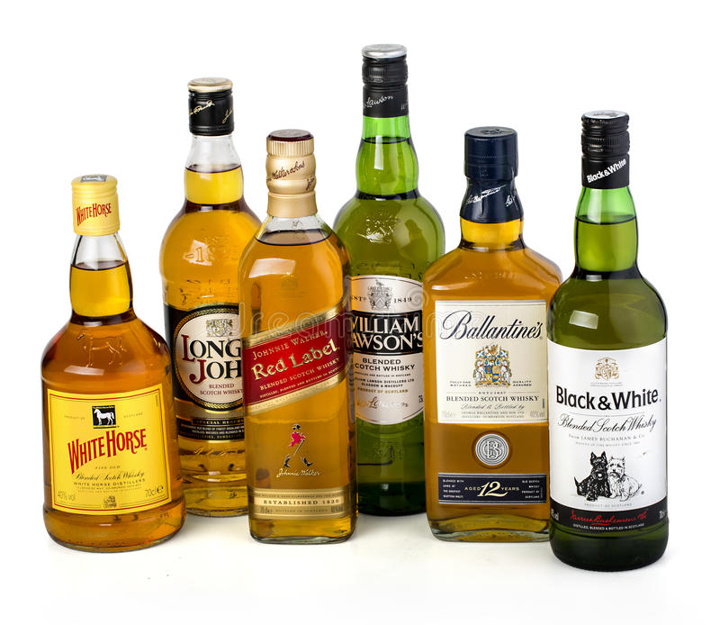 Whiskey bottles on white royalty free stock image