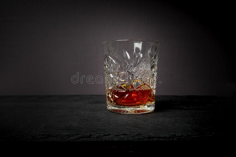 Whiskey or bourbon in a luxury heavy cut crystal glass tumbler stock images