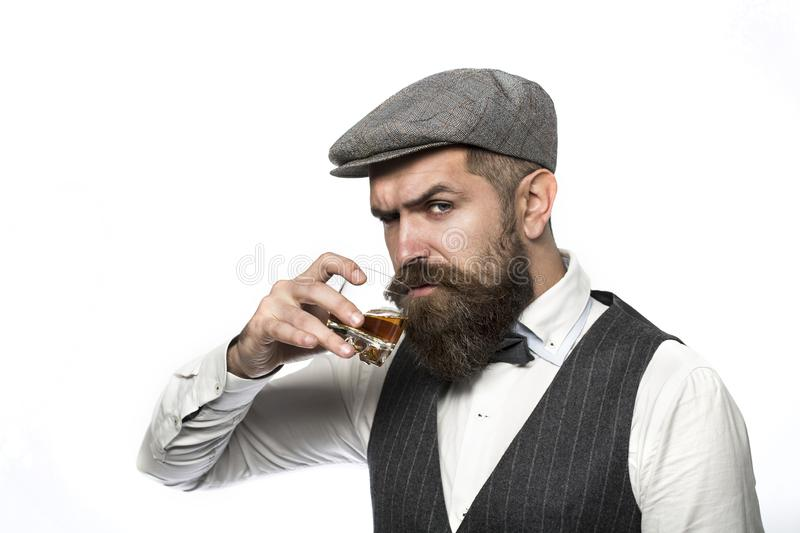 Whiskey, brandy, cognac drink. Brutal bearded man with glass of whiskey, brandy, cognac. Attractive man with a cognac royalty free stock image