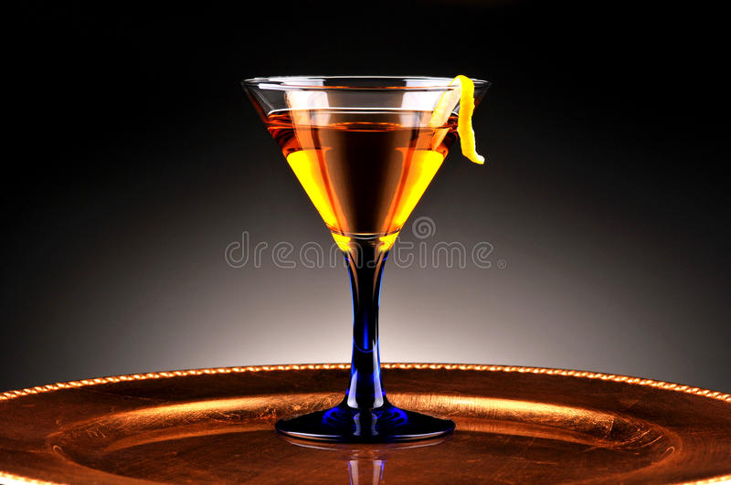 Whiskey cocktail on gold platter stock photo