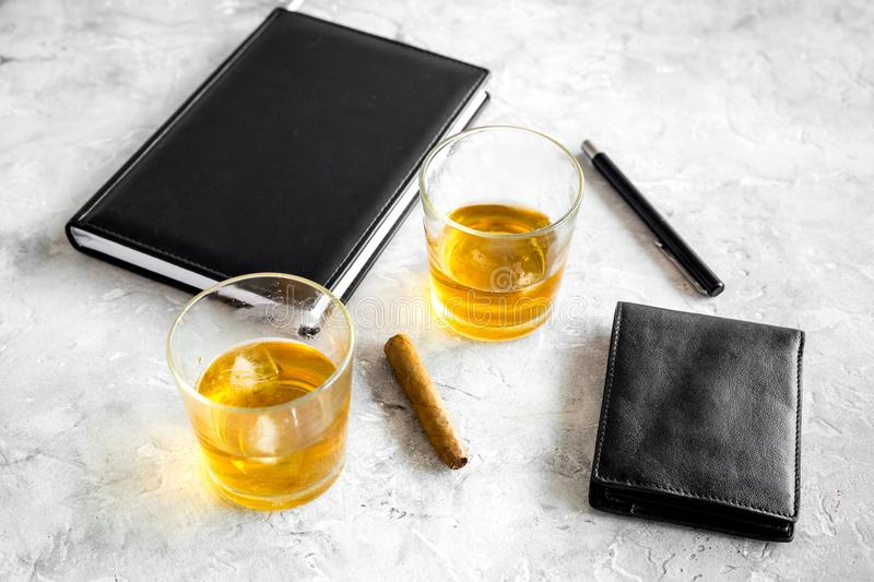 Whiskey cocktails, cigar, wallet and notebook for men meeting stone pub table background. Whiskey cocktails, cigar, wallet and notebook for men meeting on stone royalty free stock photo