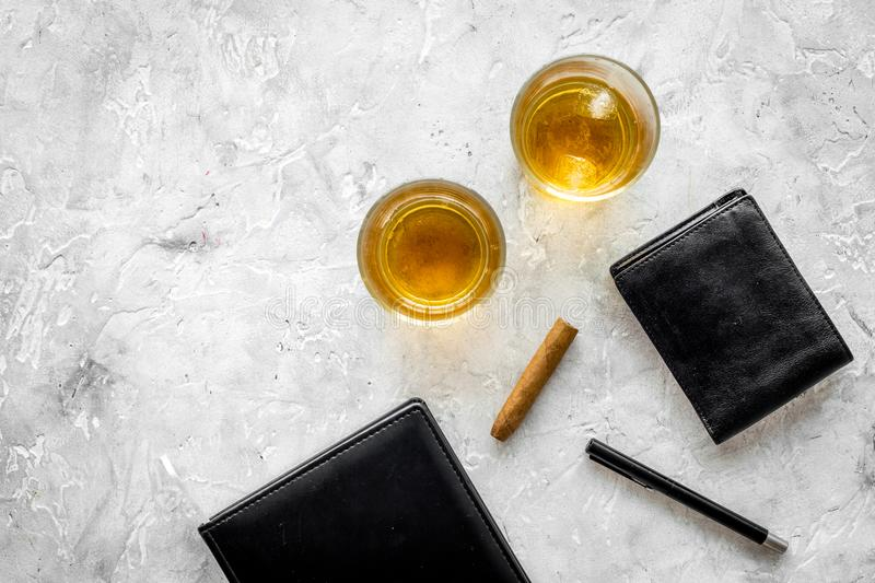 Whiskey cocktails, cigar, wallet and notebook for men meeting stone pub table background top view mock up. Whiskey cocktails, cigar, wallet and notebook for men stock images
