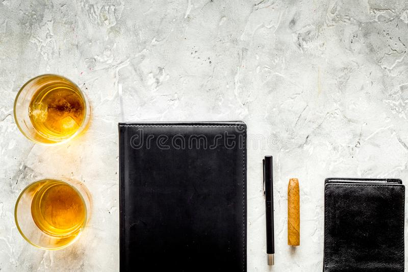 Whiskey cocktails, cigar, wallet and notebook for men meeting stone pub table background top view mock up. Whiskey cocktails, cigar, wallet and notebook for men royalty free stock photos