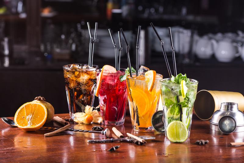 Assorted cocktails in glass glasses on a wooden stand royalty free stock image