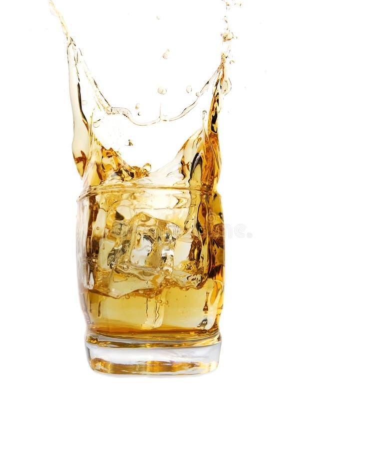 whiskey d'éclaboussure photographie stock