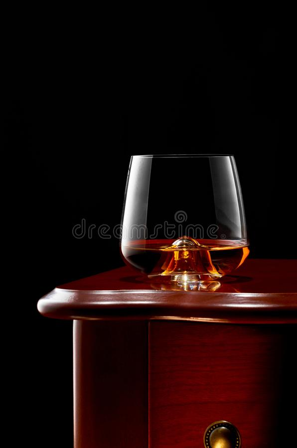 Whiskey on a dark background stock photography
