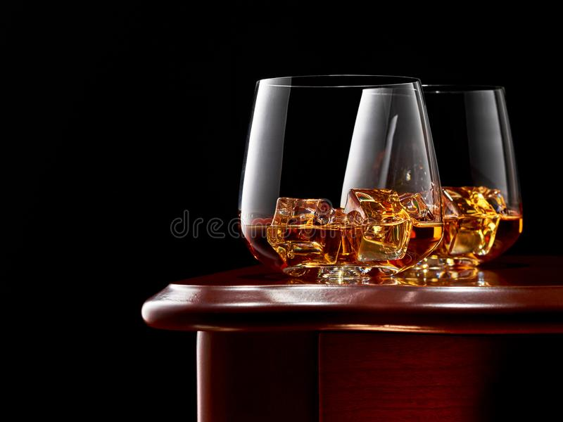 Whiskey on a dark background stock images
