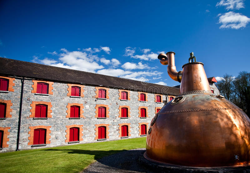 Whiskey distillery Old copper washback in Ireland stock photography