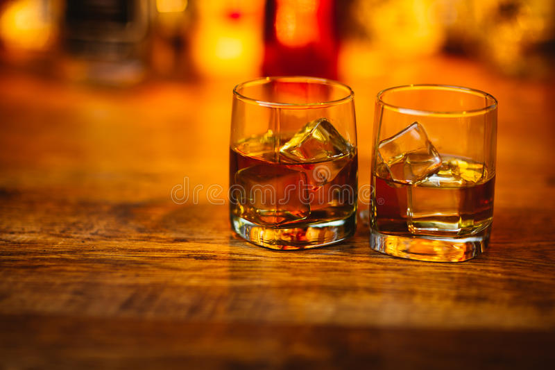Whiskey drinks on wood royalty free stock photos