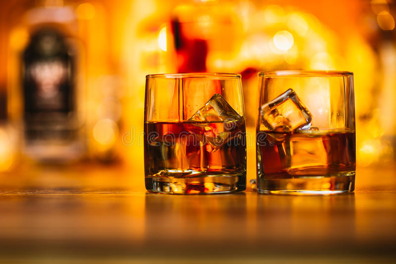 Whiskey drinks on wood royalty free stock photography