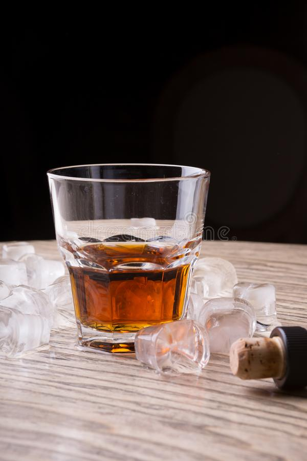Whiskey glass on a bar counter royalty free stock photos