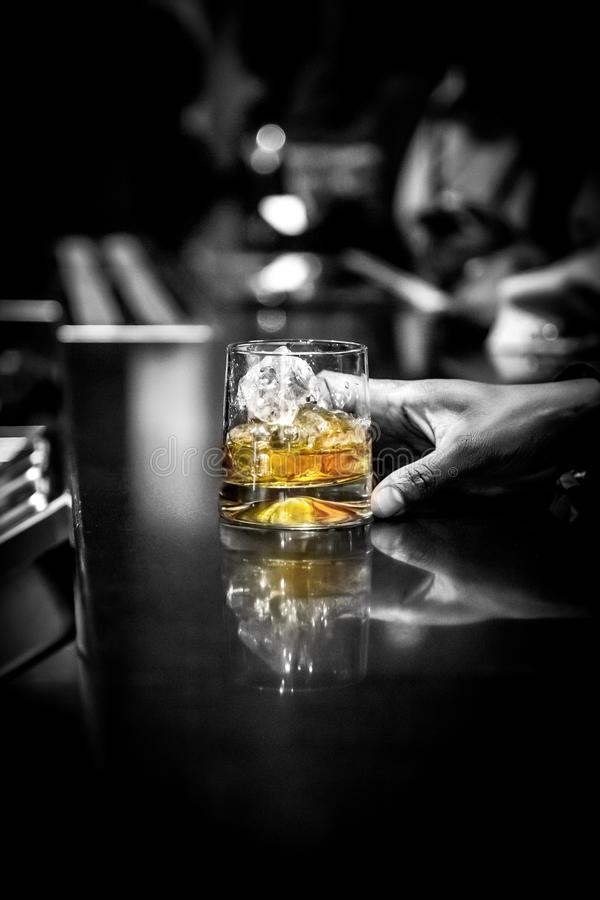 Whiskey glass on bar counter. royalty free stock photo