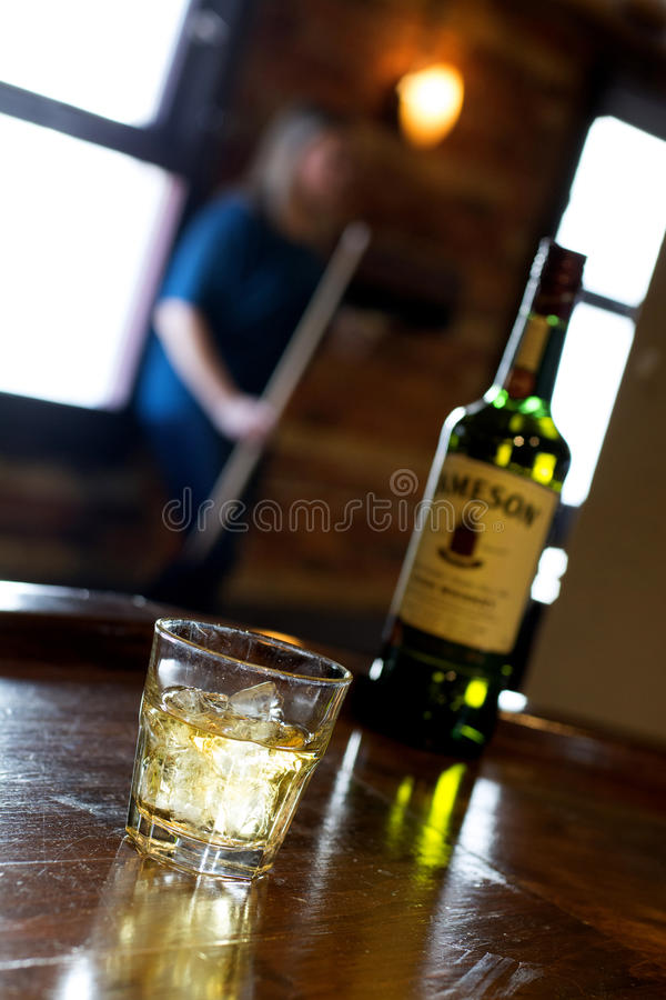 Whiskey Glass In Bar. Drinking whiskey at a pub stock photos