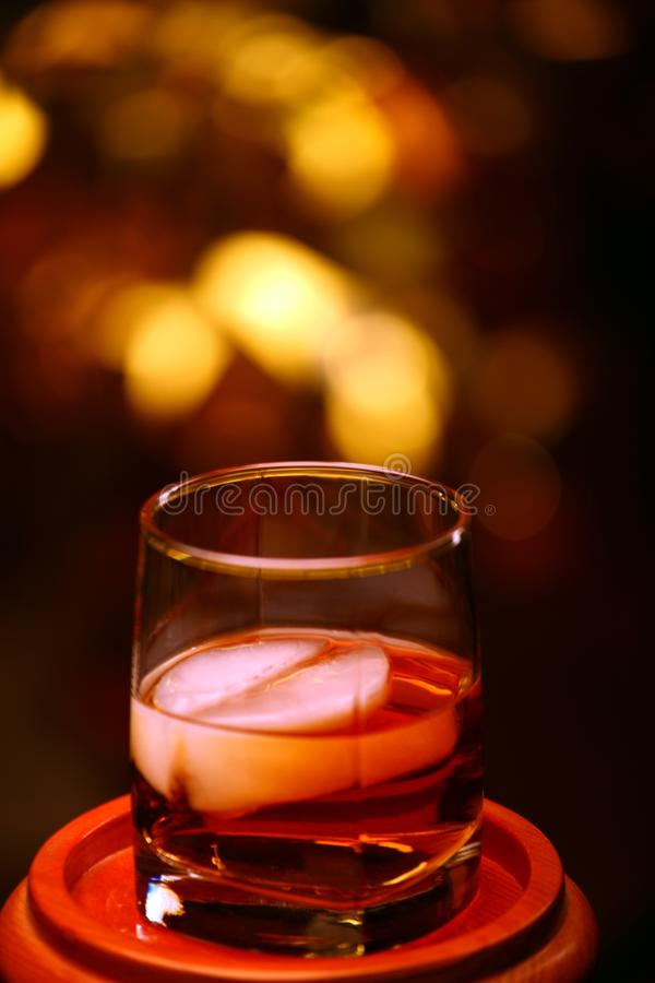 Whiskey glass gold bokeh royalty free stock images
