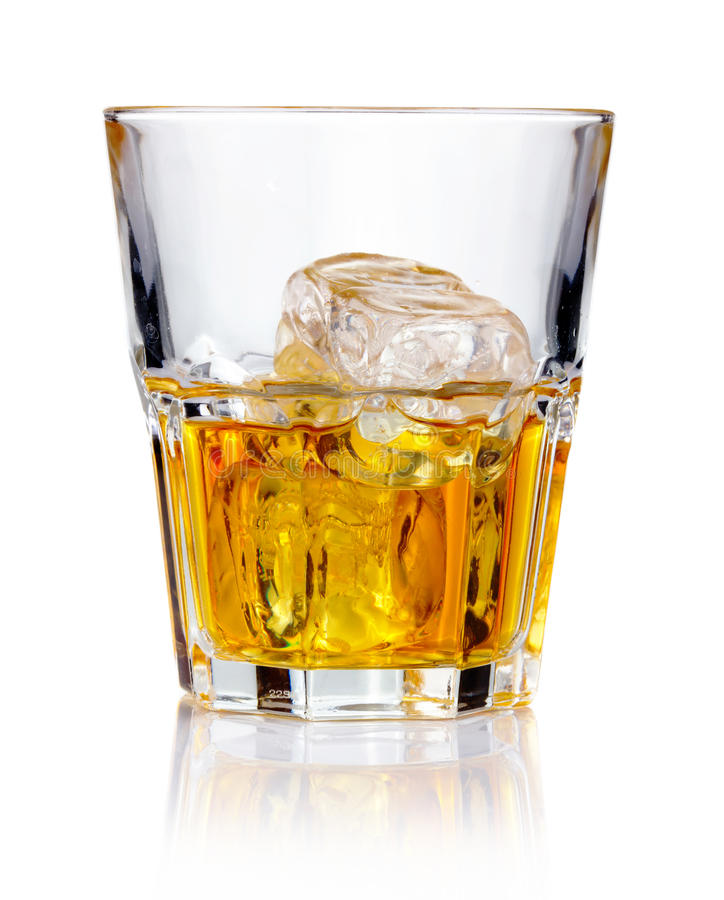 Whiskey glass with ice cubes. And reflections royalty free stock photos