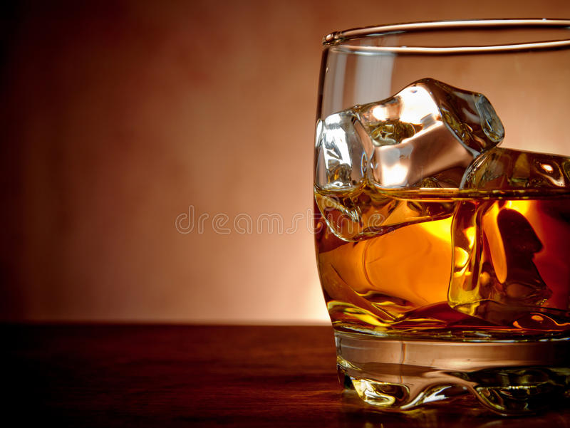 Whiskey. Glass of whiskey on the rocks royalty free stock photography
